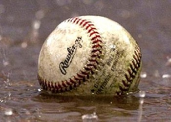 image of baseball sitting in a puddle with rain falling down around it