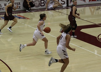 Lady Bobcat Abby Oliver bringing the ball up the floor against Evangel.