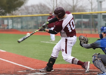 Kyle Giefer at the plate swinging the bat with catcher right behind him