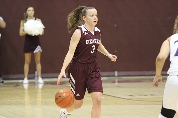 Lady Bobcat Abby Oliver bringing the ball up the floor.