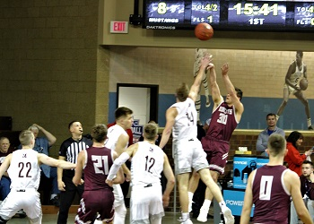 #30 Brandt Cochran taking a shot against a Morningside defender, with other players in action in the picture moving across the court