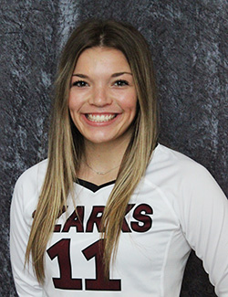 Lady Bobcat's number 11, Ryley Thixton smiles for her player picture.