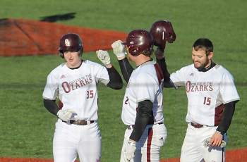 Cade Little and Teammates celebrating at home plate following first college career homerun