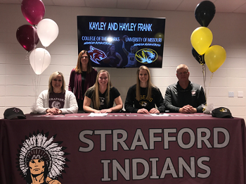 Pic of Frank sisters signing with parents and coaches