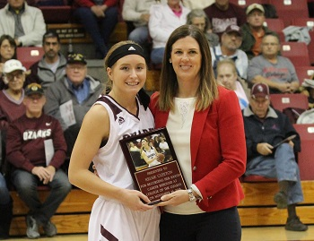 Kelsie Cleeton being presented with 1000 career rebound plaque from Coach Mullis