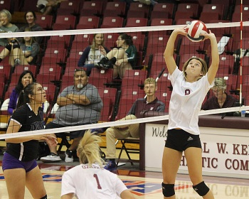 Rielly Dobbs setting the ball to a teammate