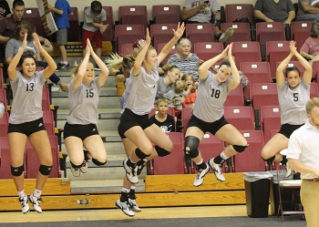 Girls on Bench Celebrating a Point by jumping in the air