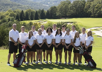 posed picture at the course of both teams with a panoramic view of the Ozark hills in the background